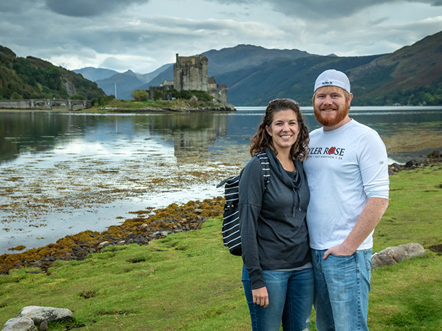 Couple with Eilean Donan castle behind