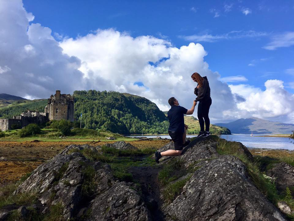 Eilean Donan Castle with couple in front proposing
