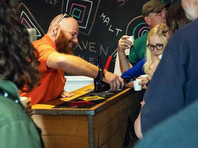 Colin, the Hairy Coo guide pouring a Scottish beer on a tour